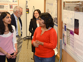 Bioengineering students and Founding Head Bruce Wheeler discuss the posters.