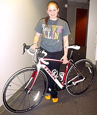 Grace Deetjen with her new bike, Phoenix.