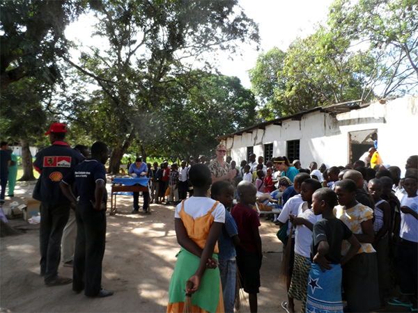 Veterinary students, professors and locals at temporary surgery site in Tanzania