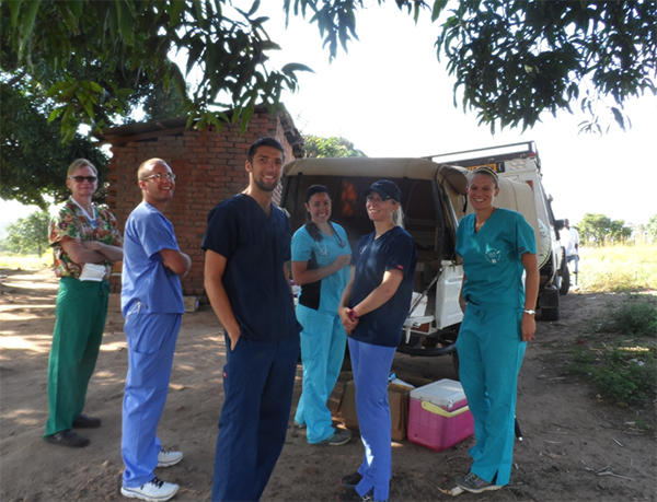 Veterinary students and veterinarian setting up temporary surgery site